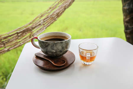 treacle: Hot coffee in cup, Hot amaricano among cornfield