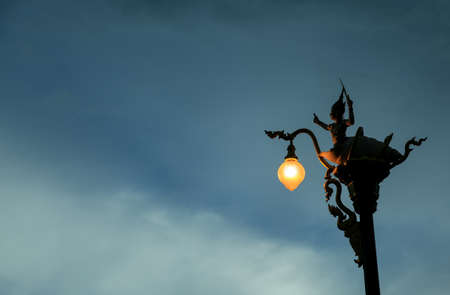 lamp post: Thai sculpture garnish Lamp post at Khonkaen Thailand. low key shot.