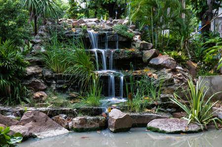 establish: waterfall at front yard., low speed shutter.