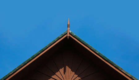 wooden roof., asis style., Thai style., Northeast of Thailand., on Blue sky blackground