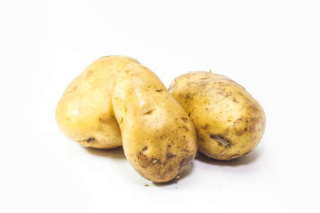spud: young potatoes on white background Stock Photo
