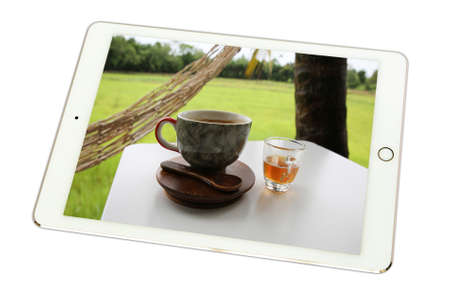 treacle: Hot coffee in cup, Hot amaricano among cornfield in tablet on white background., isolated
