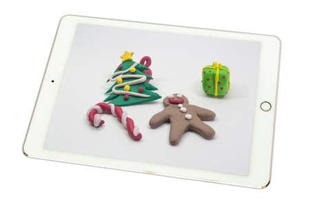 protuberance: Kid mold clay x-mas Party on white background in tablet on white background., isolated