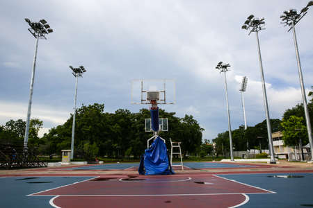 soggy: Basketball court outdoor After Rain Stock Photo