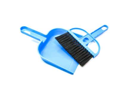 diminutive: mini blue plastic broom on white background. Stock Photo