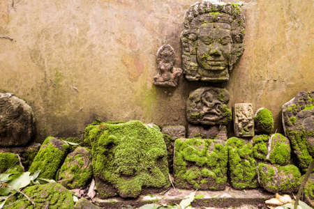 The low relief sculpture idol Abandoned., Khmer art in Thailand., vintage style. Stock Photo