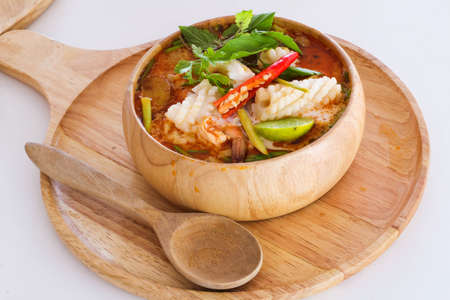 Tom yam kong soup on wihte back ground. Thai food. Standard-Bild