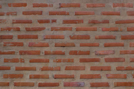 dimly lit old brick wall