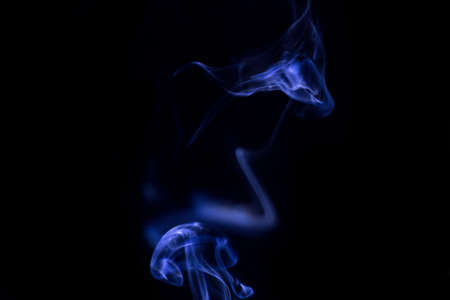 Blue Smoke on black background for art design or pattern.,Line abstract background., Smoke incense., Stock Photo