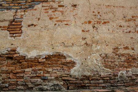 dimly lit old brick wall texture blackground.