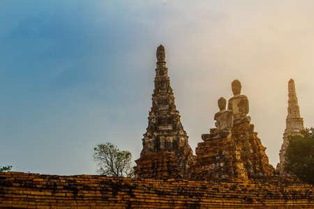 The Prang and Buddha statue in Wat Chaiwattanaram temple in Ayutthaya Historical Park , Ayutthaya province, Thailand Stock Photo