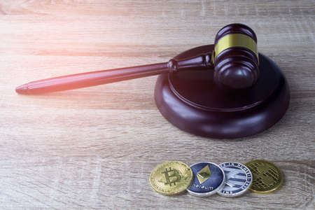 Digital Financial law concept., hammer and Digital coin on wood texture.  Stock Photo