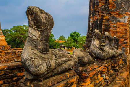 Destroyed Buddha statue at Wat Chaiwattanaram temple in Ayutthaya Historical Park , Ayutthaya province, Thailand