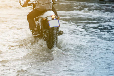 motorcycle Drive through the flood., When it rains.