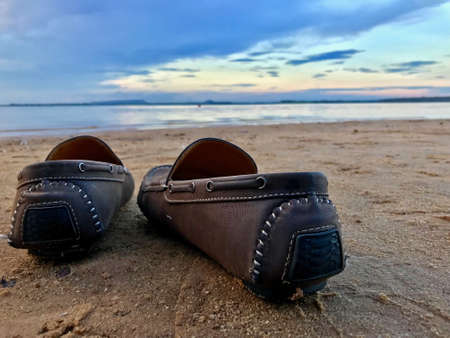 shoes On the beach at evening time.