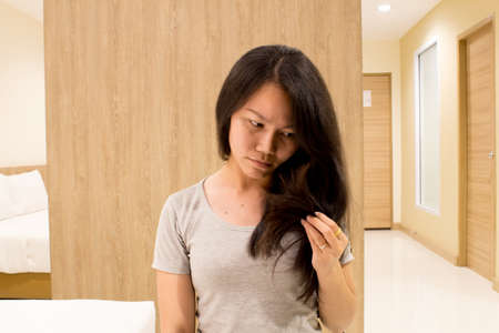 split my hair., a girl worry hair. Stock Photo