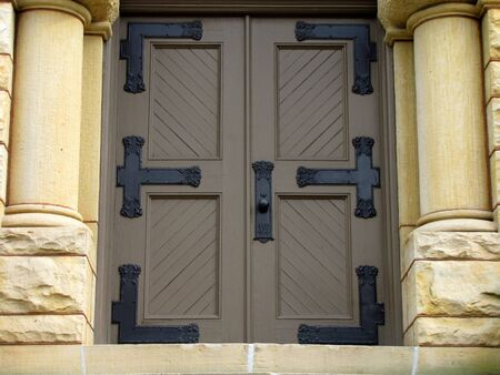 large church doors with side pillars