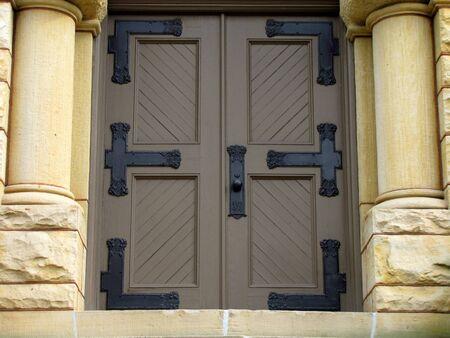 large doors: large church doors with side pillars