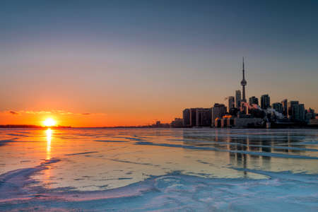 winter season: A gorgeous winter sunset over frozen Lake Ontario, with Toronto skyline.