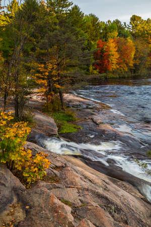 downstream: The rocky shoreline downstream from Mary Lake in autumn. Stock Photo