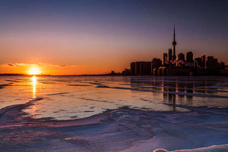 winter park: A gorgeous winter sunset over frozen Lake Ontario, with Toronto skyline.