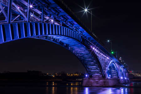 Illuminated Peace Bridge, connecting United States to Canada. Stock Photo