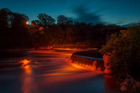 Illuminated Penmans Dam in Paris, Ontario at blue hour.