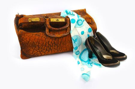 Vintage bag and shoes with scarf on white background