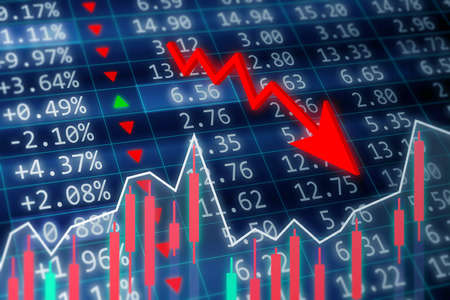 Stock market crash concept. A stock market crash is a sudden dramatic decline of stock prices across a major cross-section of a stock market. Financial data on a monitor with green arrow going up and red, green candle stick graph chart on dark background