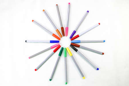 Colorful of color pens on circle arrangement set-up, blank space for text, on white paper texture background.