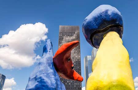 PARIS, FRANCE - August 20, 2016: Unidentified People, Deux personnages Fantastiques, Sculpture by Joan Miro 1976 in the business district of La Defense