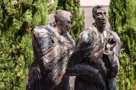 PARIS, FRANCE - August 27, 2016: La Defense, Les hommes de la Cite, The men of the City, eight Sculptures by Siptrott 1995