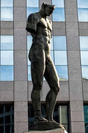 spreaded: PARIS, FRANCE - August 27, 2016: Icare, Sculpture by Igor Mitoraj 2001 in La Defense. Sculptures of Igor Mitoraj are spreaded in European Cities, USA and Japan too