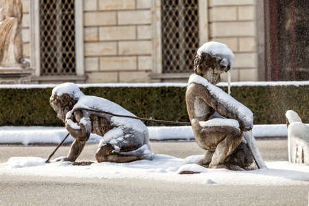 COMO, COMO LAKE - ITALY - January 13, 2017: Fountain of the triton in neoclassical Villa Olmo, Como. Close up of two putti with snow and ice