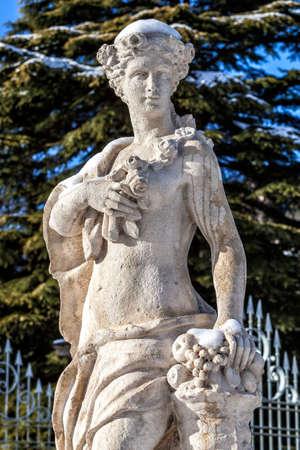COMO, COMO LAKE - ITALY - January 13, 2017: Park of neoclassical Villa Olmo in Como during the winter. Female statue with cornucopia, symbol of abundance