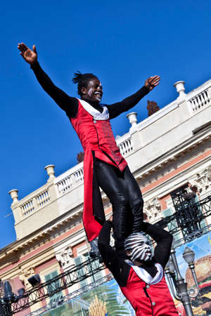 NICE - FRANCE - March 03, 2014: King of carnival 2014. The theme of Nice carnival is the gastronomy. Two acrobats