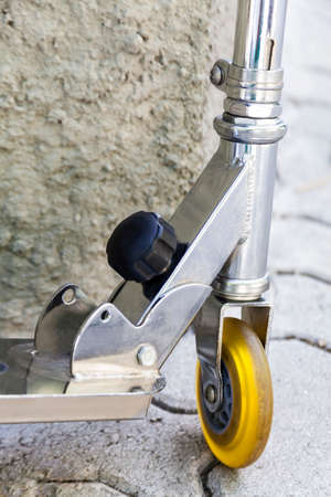 Front wheel close-up  of a metal scooter Banque d'images