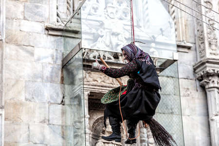 COMO, ITALY - January 6, 2017: during Epiphany an old woman flies bringing sweets to good children and coal to bad ones.  Como Lake Éditoriale