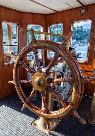 Steering-wheel in a boat cabin. Como Lake. Italy Banque d'images