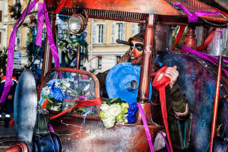 NICE - FRANCE - March 01, 2014: Carnival of Nice, Flowers' battle. A mask and a very special machine Éditoriale