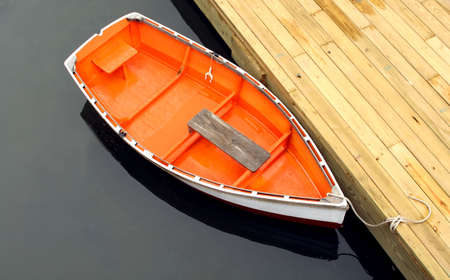 row boat tied to dock