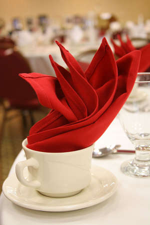 coffee cup with red linen napkin