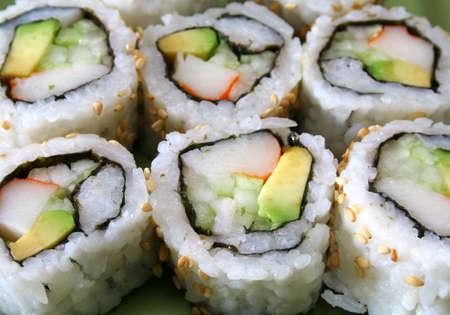a row of sushi California rolls
