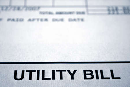 postmail: close up of a utility bill done in a blue tone