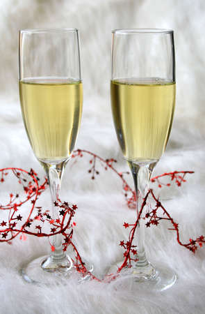 Wine and red foil string on a dramatic looking background.