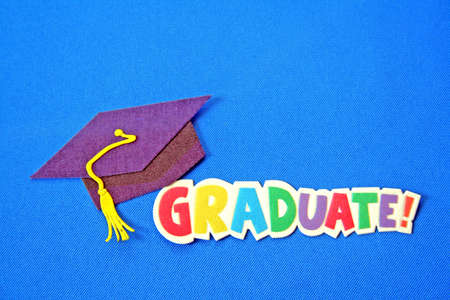 graduation cap and tassel with colorful words of graduation all on a blue background. Stock Photo - 2727226