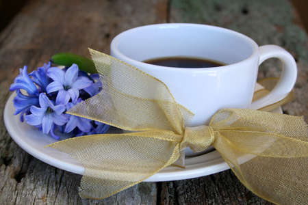 coffee cup on a saucer with a bow and Hyacinth. Perfect image for mothers day photo