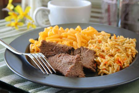 the sides: Steak dinner with sides. Stock Photo