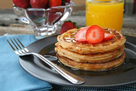 oj: Strawberry waffles with fresh strawberries and OJ.