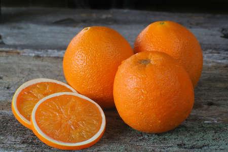 oj: Fresh ripe oranges whole and sliced.